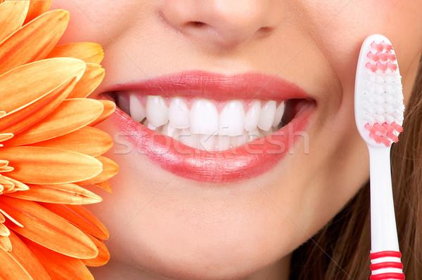 улыбка зубов красивая женщина свежие цветок женщины Сток-фото © Kurhan