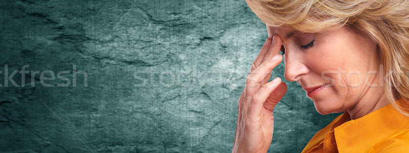 Woman having a migraine headache. Stock photo © Kurhan