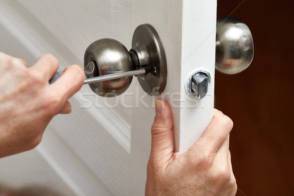 Door knob installation. Stock photo © Kurhan