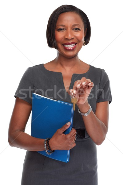 African-American realtor woman with key. Stock photo © Kurhan