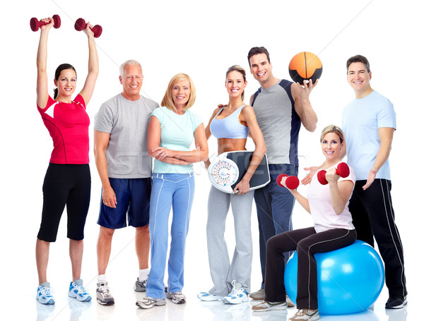 Gym and Fitness. Smiling people. Stock photo © Kurhan