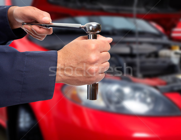 Hand of car mechanic with wrench. Stock photo © Kurhan