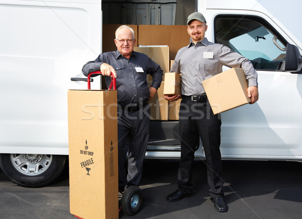 Group of delivery man with a parcel. Stock photo © Kurhan