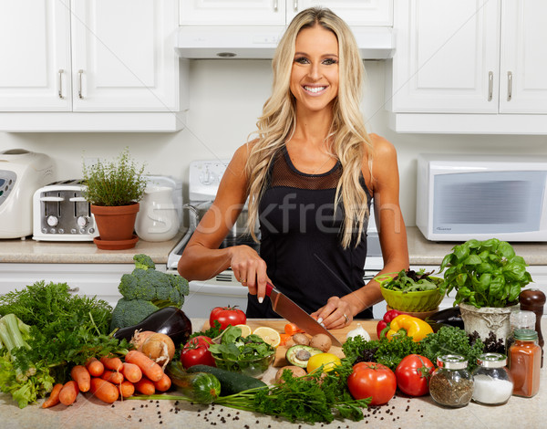 Young woman cooking in the kitchen. Stock photo © Kurhan
