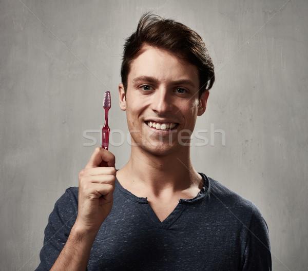 Man with toothbrush. Stock photo © Kurhan