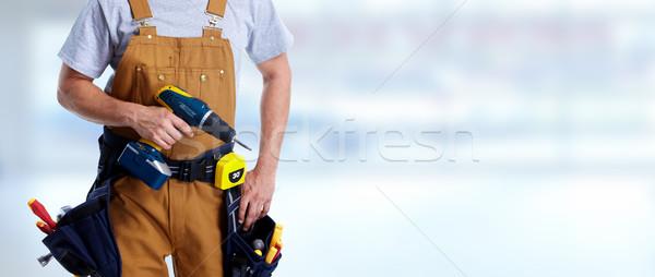 Travailleur de la construction forage professionnels mains outil ceinture Photo stock © Kurhan