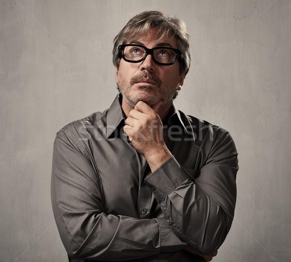 Myślenia człowiek portret szary ściany Zdjęcia stock © Kurhan