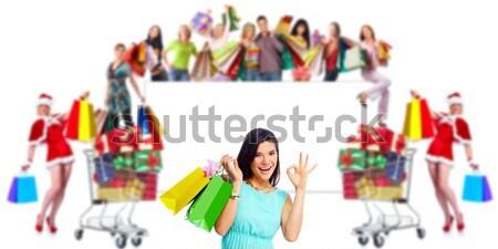 Shopping woman with gifts. Stock photo © Kurhan