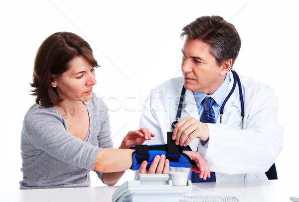 Doctor and patient woman. Stock photo © Kurhan