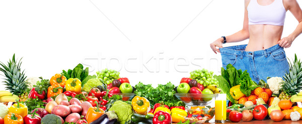 Stock photo: Woman losing weight.