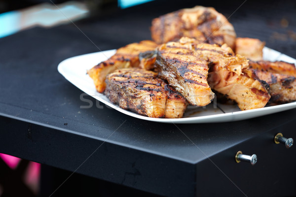 Salmon fish roast on barbecue grill. Stock photo © Kurhan