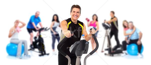 Man exercising on elliptical trainer. Stock photo © Kurhan