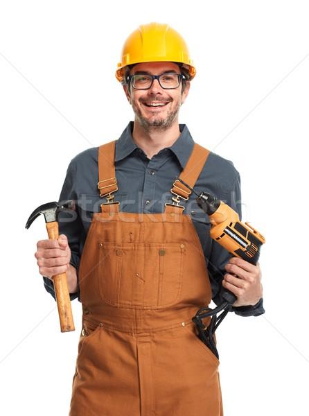 Travailleur de la construction souriant professionnels casque isolé blanche Photo stock © Kurhan