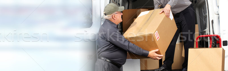 Delivery postman with a box Stock photo © Kurhan