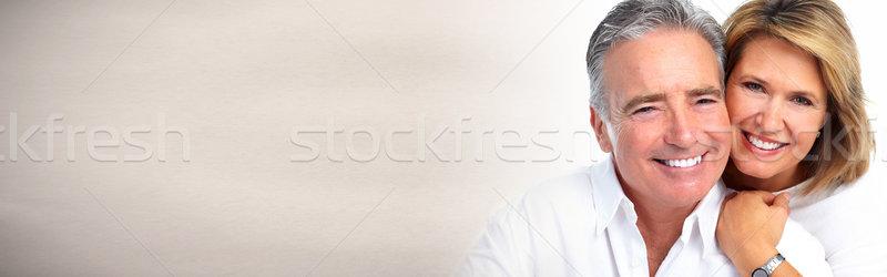 Starszy para uśmiechnięty szczęśliwy starszych para szary Zdjęcia stock © Kurhan