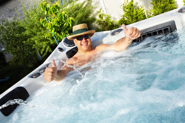 Man having massage in  hot tub spa. Stock photo © Kurhan
