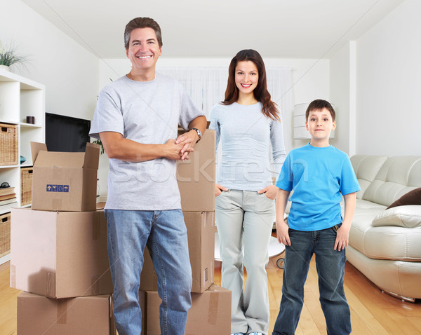 Family with moving boxes in new apartment. Stock photo © Kurhan