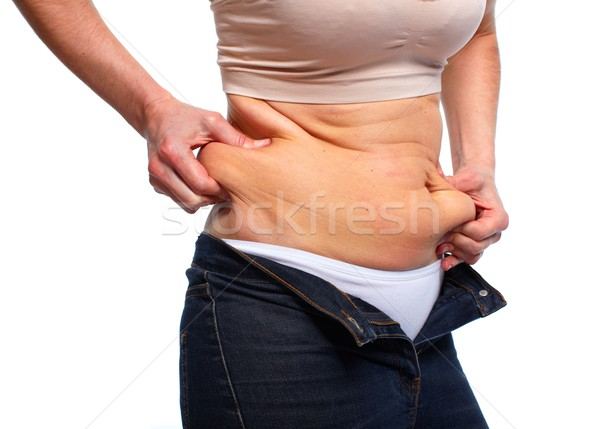 Woman with fat belly. Stock photo © Kurhan