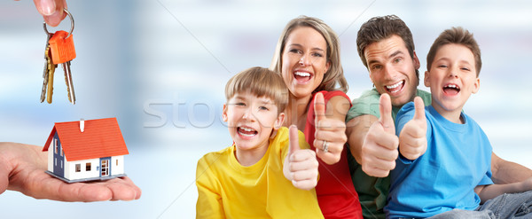 Happy family and little house. Stock photo © Kurhan