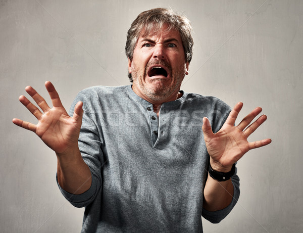 Stock photo: scared man face.