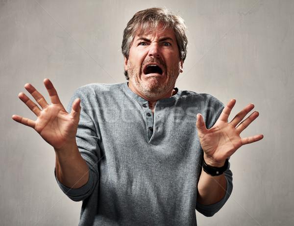 Peur homme visage étonné maturité Photo stock © Kurhan