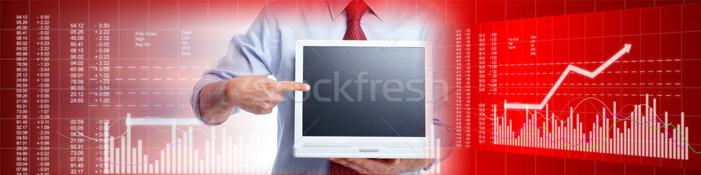 Investor with laptop computer Stock photo © Kurhan