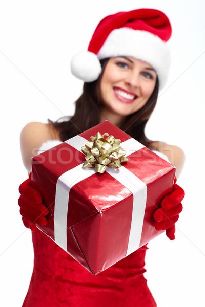 Santa helper Christmas girl with a present. Stock photo © Kurhan