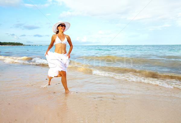 happy woman on punta cana beach stock photo kurhan 3513998