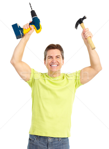 man with cordless drill and hammer Stock photo © Kurhan