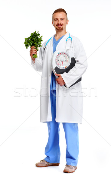 Doctor nutritionist  with scales. Stock photo © Kurhan