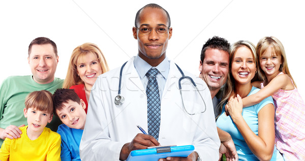 Medical doctor and happy family. Stock photo © Kurhan