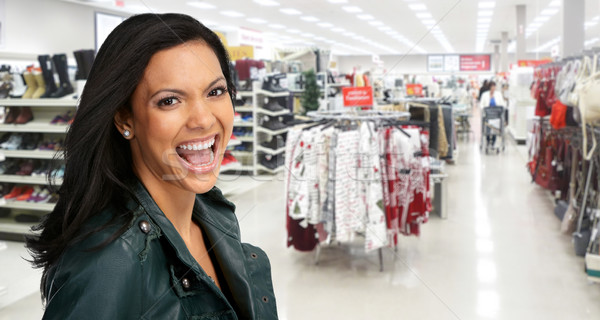 Happy asian girl in a shopping mall. Stock photo © Kurhan