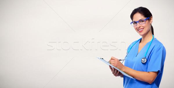 Medici medico iscritto prescrizione infermiera donna Foto d'archivio © Kurhan