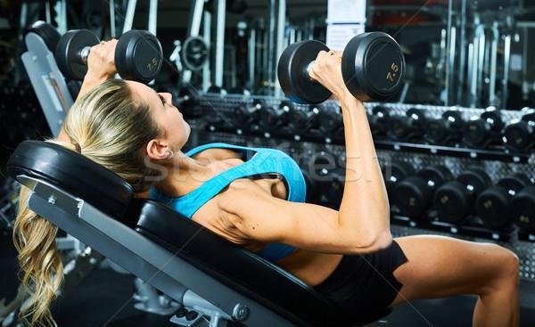 Bench press dumbbell workout Stock photo © Kurhan
