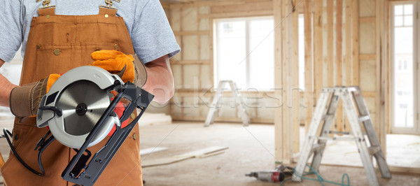Pracownika ręce elektryczne widział zawodowych pracownik budowlany Zdjęcia stock © Kurhan