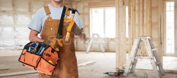 Construction worker with hammer. Stock photo © Kurhan