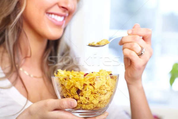 Woman eating cereals Stock photo © Kurhan