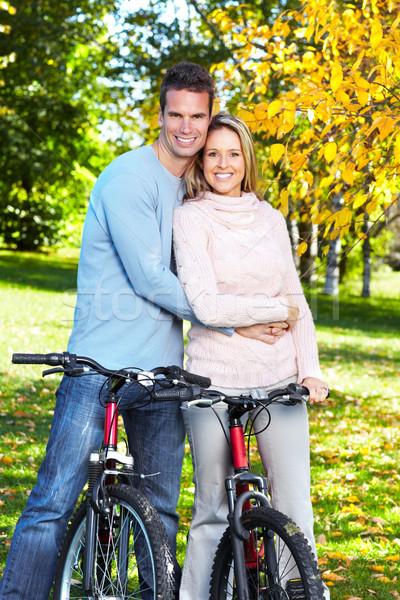 Stok fotoğraf: Mutlu · bisiklet · park · aile · kız
