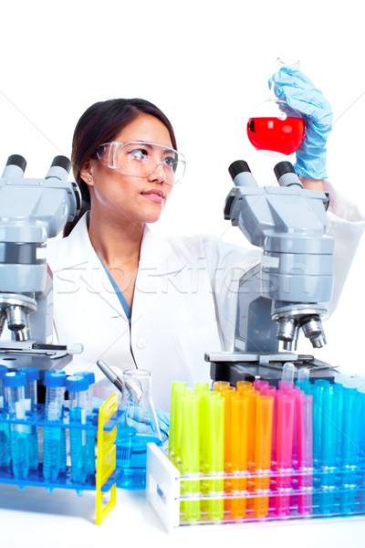 Scientific woman working in laboratory. Stock photo © Kurhan