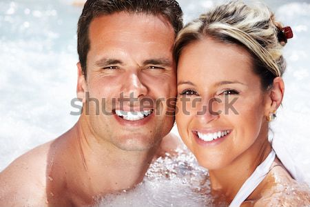 Young couple in jacuzzi. Stock photo © Kurhan