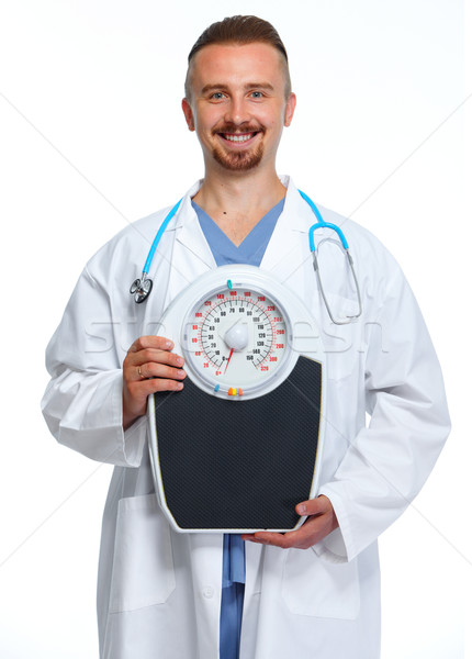Doctor with body scales. Stock photo © Kurhan