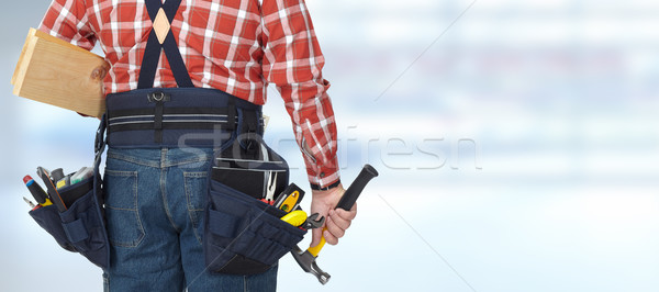 Builder with hammer and wooden planks. Stock photo © Kurhan