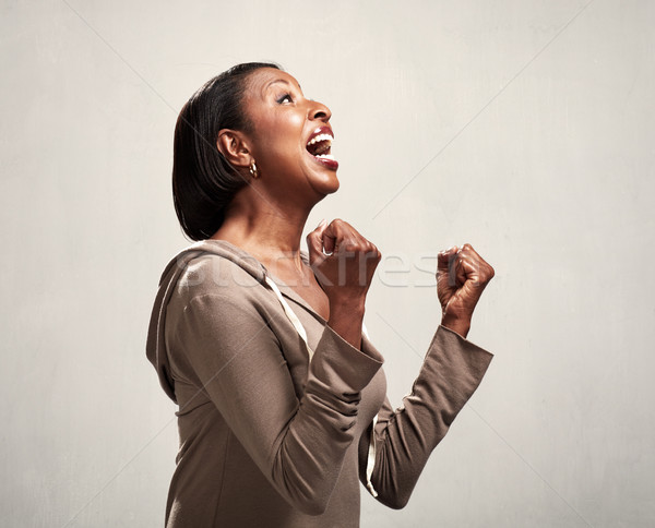 Happy surprised black woman profile Stock photo © Kurhan