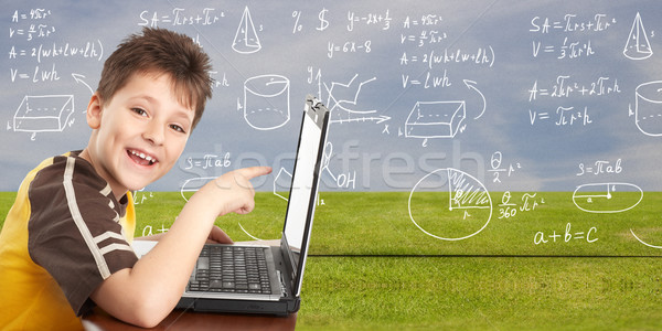 Stock photo: Young boy with laptop computer.