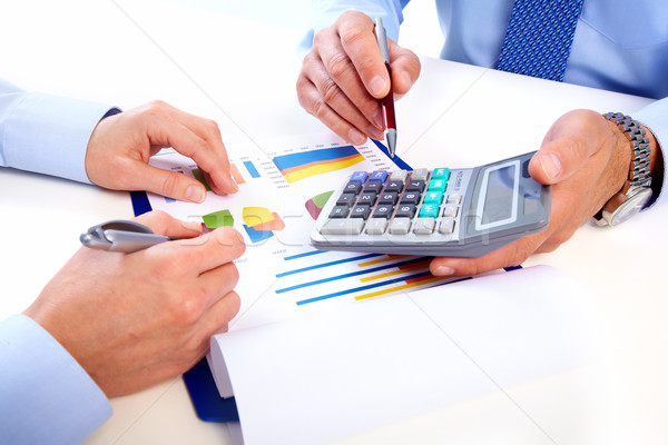 Hands of business people with calculator. Stock photo © Kurhan