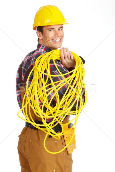 Electricista jóvenes guapo amarillo uniforme blanco Foto stock © Kurhan