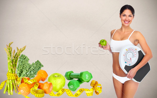 Beautiful young woman with scales. Stock photo © Kurhan