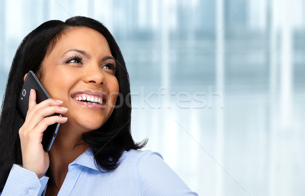 Asian business woman calling by cellular.  Stock photo © Kurhan