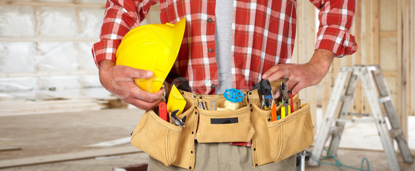 Construction worker with helmet and tool belt. Stock photo © Kurhan