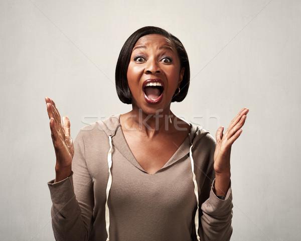 Happy black woman Stock photo © Kurhan